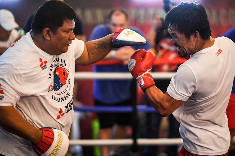 Manny Pacquiao suffered a shock defeat to Australia's Jeff Horn last year. (AFP Photo/Mohd RASFAN)