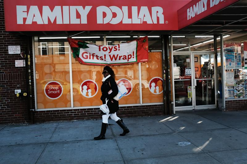 NEW YORK, NEW YORK - DECEMBER 11: A woman walks by a Family Dollar store on December 11, 2018 in the Brooklyn borough of New York City. As the income gap between rich and poor continues to grow, dollar and 99 cent stores have become increasingly popular in both urban and rural America. Dollar General, one of several discount retail chains, has become one of the fastest growing retailers in the U.S. According to the Institute for Local Self Reliance, there are now over 30,000 dollar stores in the U.S., up from around 18,000 a decade ago. Dollar General and Dollar Tree alone are expected to have 50k stores in the next few years. (Photo by Spencer Platt/Getty Images)