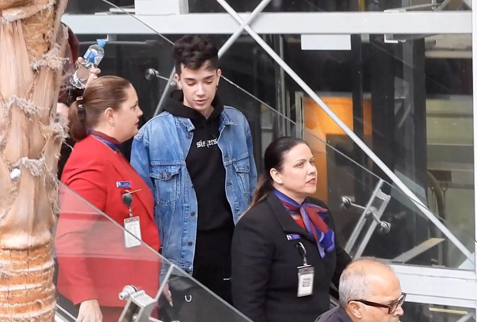 James Charles has been escorted through Brisbane Airport in his first public sighting since losing millions of followers. Photo: Backgrid Australia