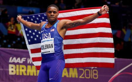 FILE PHOTO: Christian Coleman of the U.S celebrates at Arena Birmingham, Birmingham, Britain - March 3, 2018. Action Images via Reuters/John Sibley