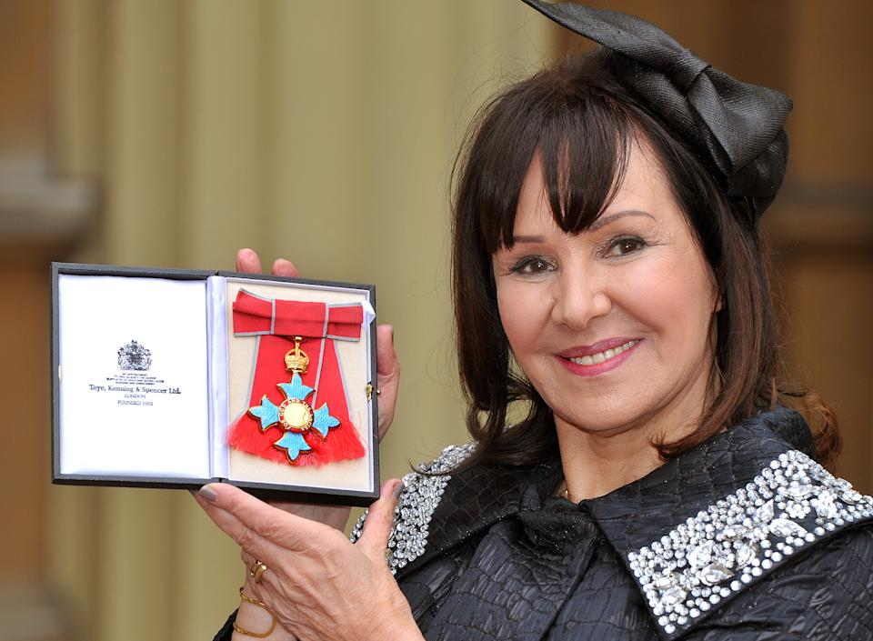 LONDON, ENGLAND - FEBRUARY 13:  Arlene Phillips holds her Commander of the British Empire (CBE) medal after it was presented to her by Queen Elizabeth II at the Investiture Ceremony at Buckingham Palace on February 13, 2012 in London, England.  (Photo by John Stillwell - WPA Pool/Getty Images)