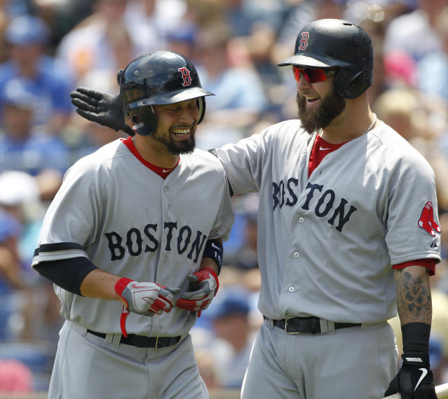 Boston Red Sox's Shane Victorino, left, is congratulated by teammate Mike Napoli, right, after scoring from third base on a throwing error by Kansas City Royals catcher Salvador Perez in the first inning of a baseball game at Kauffman Stadium in Kansas City, Mo., Sunday, Aug. 11, 2013. (AP Photo/Colin E. Braley)