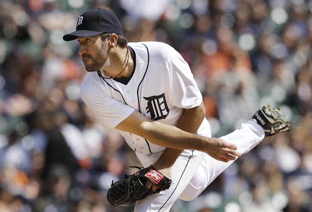 Detroit Tigers starting pitcher Justin Verlander throws during the first inning of a baseball game against the Kansas City Royals in Detroit, Monday, March 31, 2014. (AP Photo/Carlos Osorio)