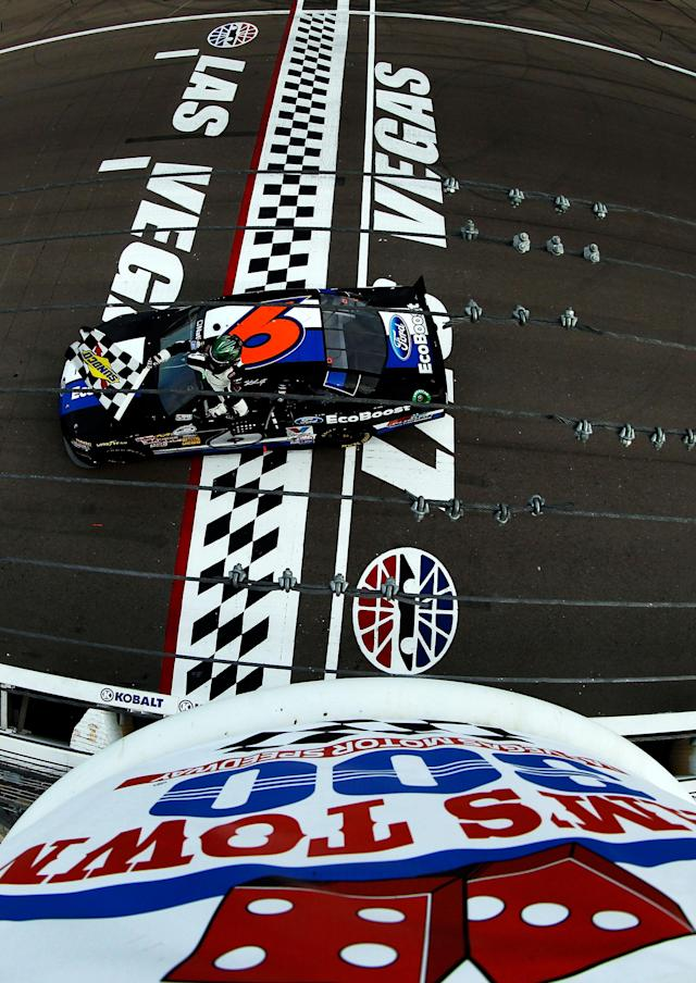 LAS VEGAS, NV - MARCH 10: Ricky Stenhouse Jr., driver of the #6 Ford EcoBoost Ford, celebrates with the checkered flag after winning the NASCAR Nationwide Series Sam's Town 300 at Las Vegas Motor Speedway on March 10, 2012 in Las Vegas, Nevada. (Photo by Tom Pennington/Getty Images)
