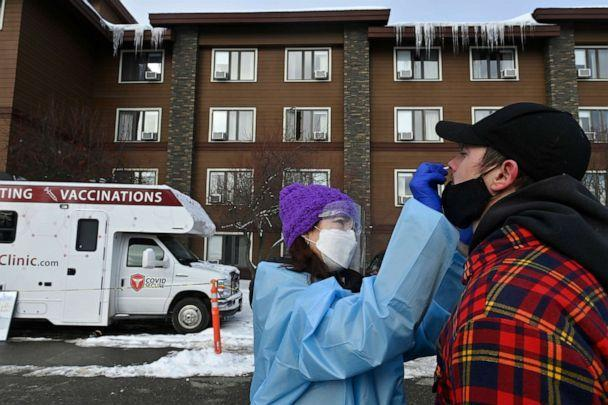 PHOTO: Dr. Jodie Guest tests Iditarod musher Matthew Failor for COVID-19 at a mobile clinic in front of Lakefront Hotel in Anchorage, Alaska, March 3, 2021. (Marc Lester/Anchorage Daily News via AP, FILE)