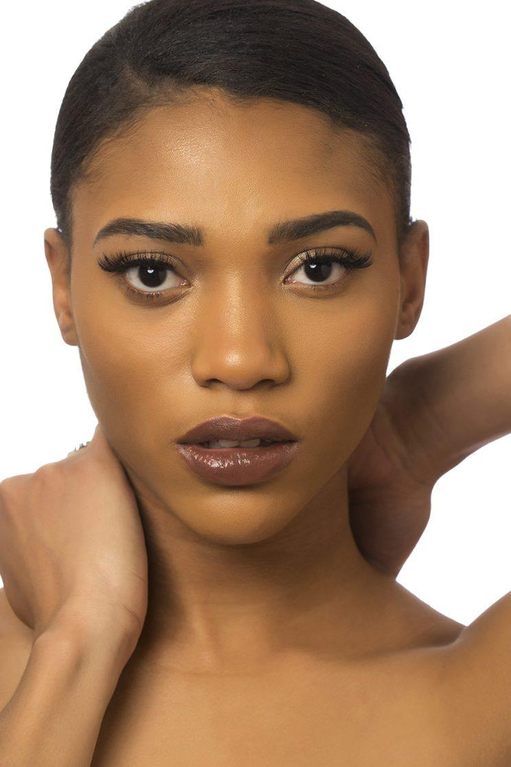 A model poses wearing one of the nude lipsticks from Mented Cosmetics.