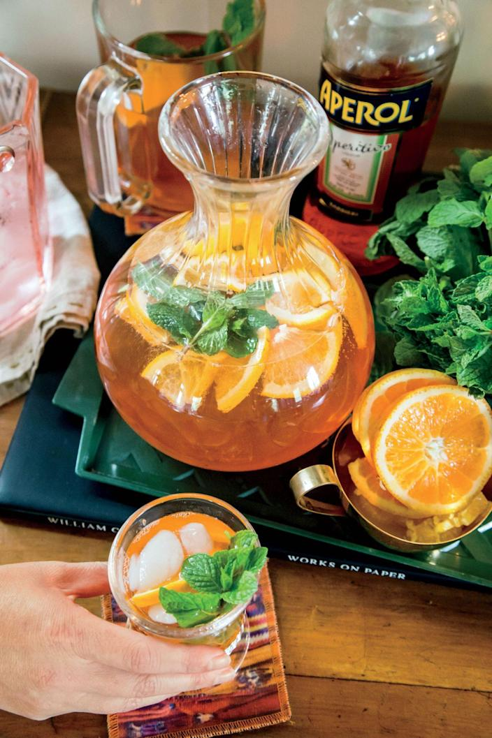 """<p><strong>Recipe: <a href=""""https://www.southernliving.com/recipes/aperol-and-blood-orange-mint-spritz-recipe"""" rel=""""nofollow noopener"""" target=""""_blank"""" data-ylk=""""slk:Aperol and Blood Orange-Mint Spritz"""" class=""""link rapid-noclick-resp"""">Aperol and Blood Orange-Mint Spritz</a><br></strong><br>Just four ingredients and a few stirs are needed to make this Aperol Spritz. </p>"""