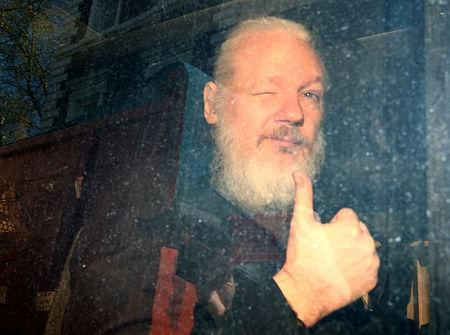 FILE PHOTO: WikiLeaks founder Julian Assange arrives at the Westminster Magistrates Court, after he was arrested  in London, Britain April 11, 2019. REUTERS/Hannah McKay/File Photo
