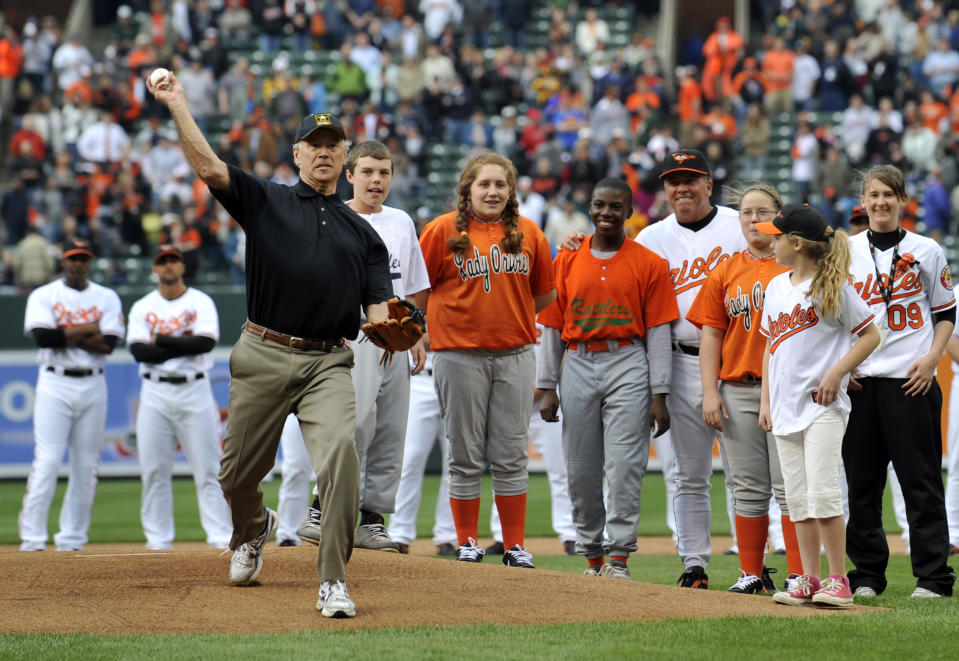FILE - In this April 6, 2009, file photo, Vice President Joe Biden throws out the first pitch prior to the Baltimore Orioles and the New York Yankees opening day baseball game at Camden Yards in Baltimore. The Washington Nationals have invited President-elect Biden to throw out the ceremonial first ball when they host the New York Mets at Nationals Park on opening day next season. (AP Photo/Gail Burton, File)