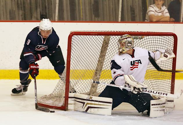 LAKE PLACID, NY - AUGUST 02: Jack Eichel #9 of USA Blue is stopped by Thatcher Demko #1 of USA White during the 2014 USA Hockey Junior Evaluation Camp at Lake Placid Olympic Center on August 2, 2014 in Lake Placid, New York. (Photo by Bruce Bennett/Getty Images)