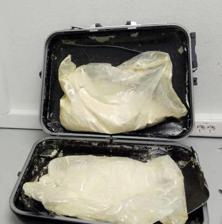 A photo provided by the Greek police shows 11 kilos of heroin hidden in the suitcase of a British citizen, that was seized at the Eleftherios Venizelos International Airport in Athens