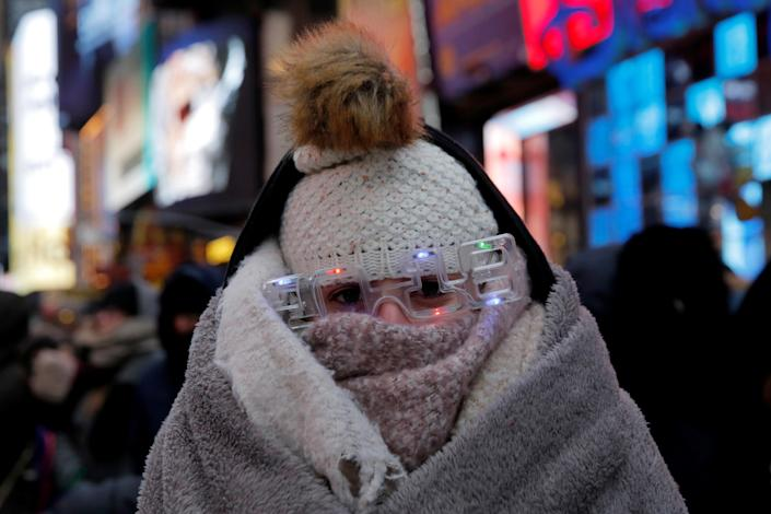 Elena Barduniotis from Colorado waits in Times Square during New Year's celebrations Dec. 31. (Photo: Andrew Kelly/Reuters)