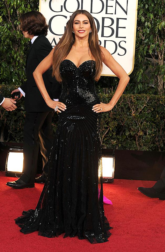 "Sofia Vergara Grade: A Once again, Sofia Vergara put her dangerous curves on display in a strapless black sequined gown by Michael Cinco – a designer she had never heard of. Nevertheless, the ""Modern Family"" siren loved the sparkling dress and we can see why!"