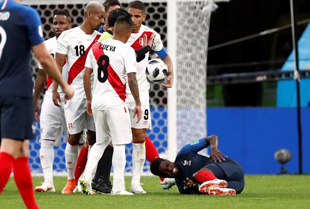 Soccer Football - World Cup - Group C - France vs Peru - Ekaterinburg Arena, Yekaterinburg, Russia - June 21, 2018 France's Samuel Umtiti reacts after sustaining an injury REUTERS/Damir Sagolj