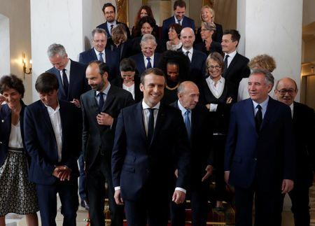 French President Emmanuel Macron and Prime Minister Edouard Philippe pose for a family photo after the first cabinet meeting at the Elysee Palace in Paris