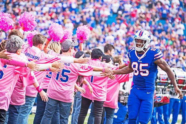 Charles Clay of the Buffalo Bills meets a group of pink-clad fans before a game against the San Francisco 49ers in October 2016. (Photo: Getty Images)