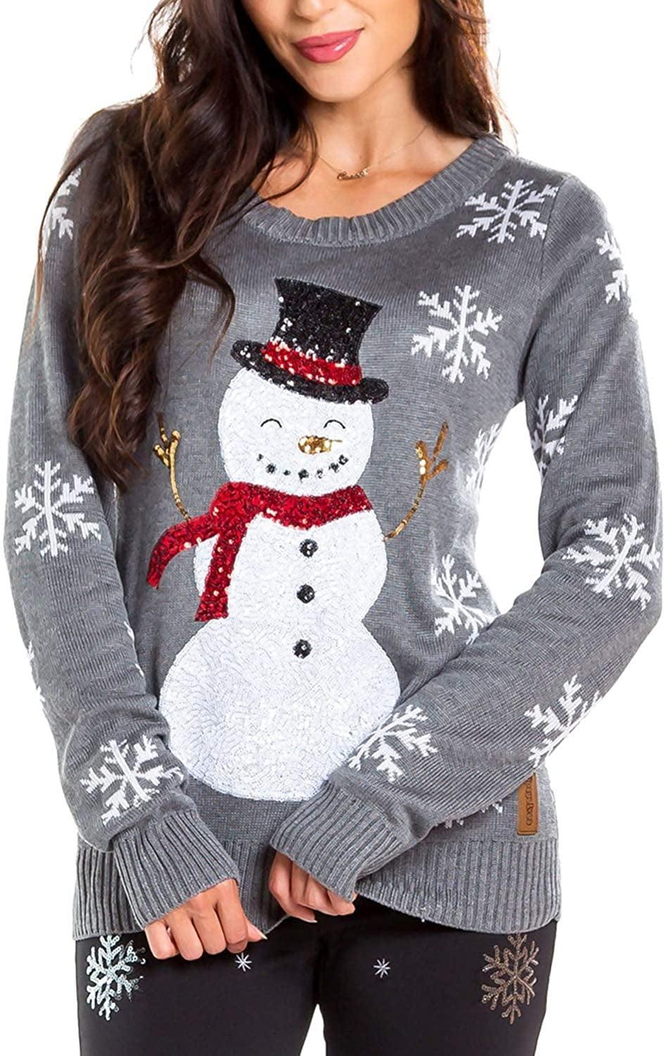 """<p>""""Let It Snow"""" will go through your head every time you slip into this <span>Sequin Snowman Christmas Sweater</span> ($50).</p>"""