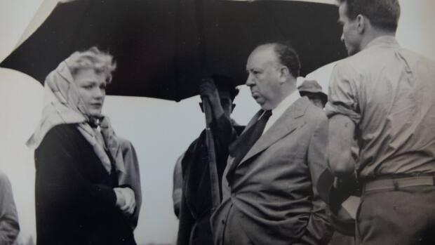 Alfred Hitchcock, centre, on the set of I Confess filmed in 1952. (Submitted by Allan O'Neill/Warner Bros. - image credit)