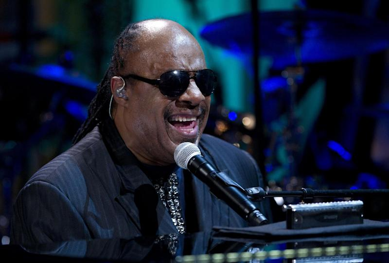 """FILE - In this Wednesday, May 9, 2012 file photo, Stevie Wonder performs during the """"In Performance at the White House"""" in the East Room of the White House in Washington, honoring songwriters Burt Bacharach and Hal David, recipients of the 2012 Library of Congress Gershwin Prize for Popular Song. Two people charged with extorting the Grammy-winning musician pleaded no contest to the charges on Monday Sept. 24, 2012, and have been sentenced to serve 292 days in jail. (AP Photo/Carolyn Kaster, File)"""