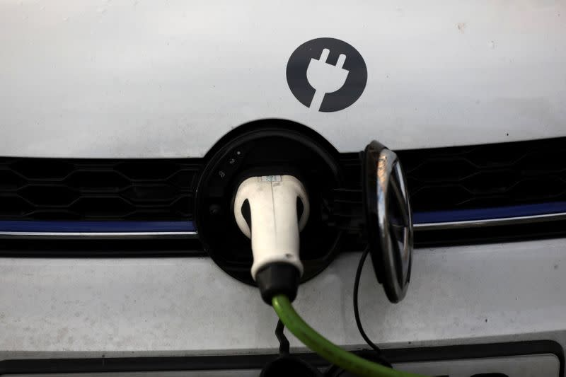 FILE PHOTO: A car is plugged in at a charging point for electric vehicles in London