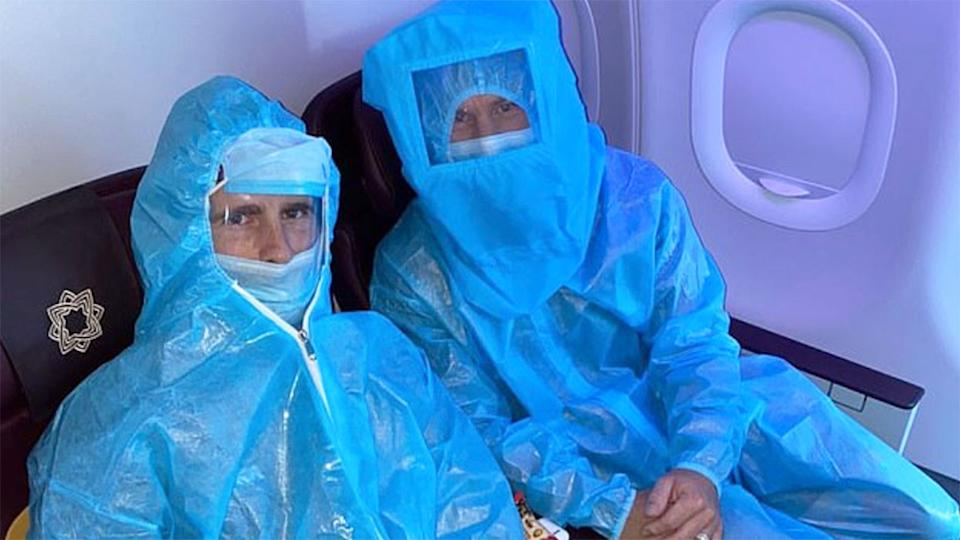 This photo shows cricketers Kane Williamson and David Warner in full PPE on a flight in India.