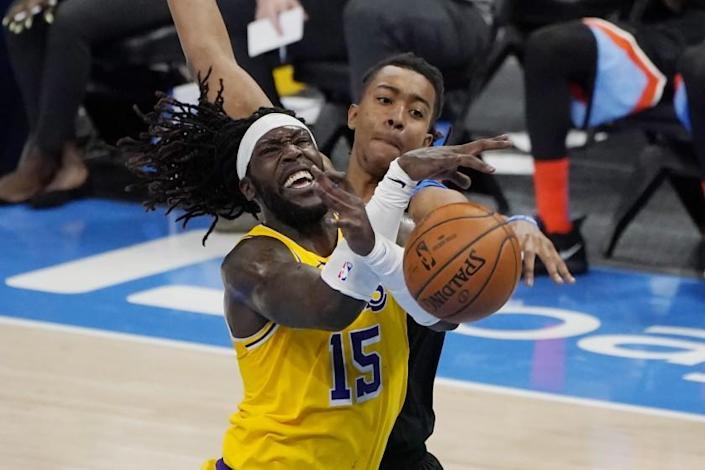 Los Angeles Lakers center Montrezl Harrell (15) is fouled by Oklahoma City Thunder center Moses Brown, rear, in the second half of an NBA basketball game Wednesday, Jan. 13, 2021, in Oklahoma City. (AP Photo/Sue Ogrocki)