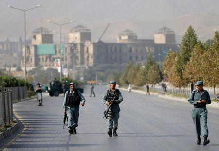 Afghan policemen walk after an attack at the American University of Afghanistan in Kabul, Afghanistan August 25, 2016. REUTERS/Mohammad Ismail