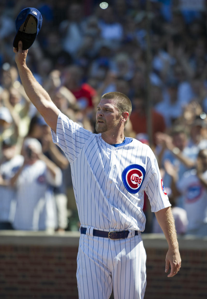 Chicago Cubs relief pitcher Kerry Wood tips his hat to the crowd after being taken out during the eight inning of a baseball game against the Chicago White Sox, Friday, May 18, 2012 in Chicago. The White Sox won 3-2. Wood faced one batter, striking out the White Sox's Dayan Viciedo, in what was likely his final appearance before retiring from baseball.  (AP Photo/Brian Kersey)