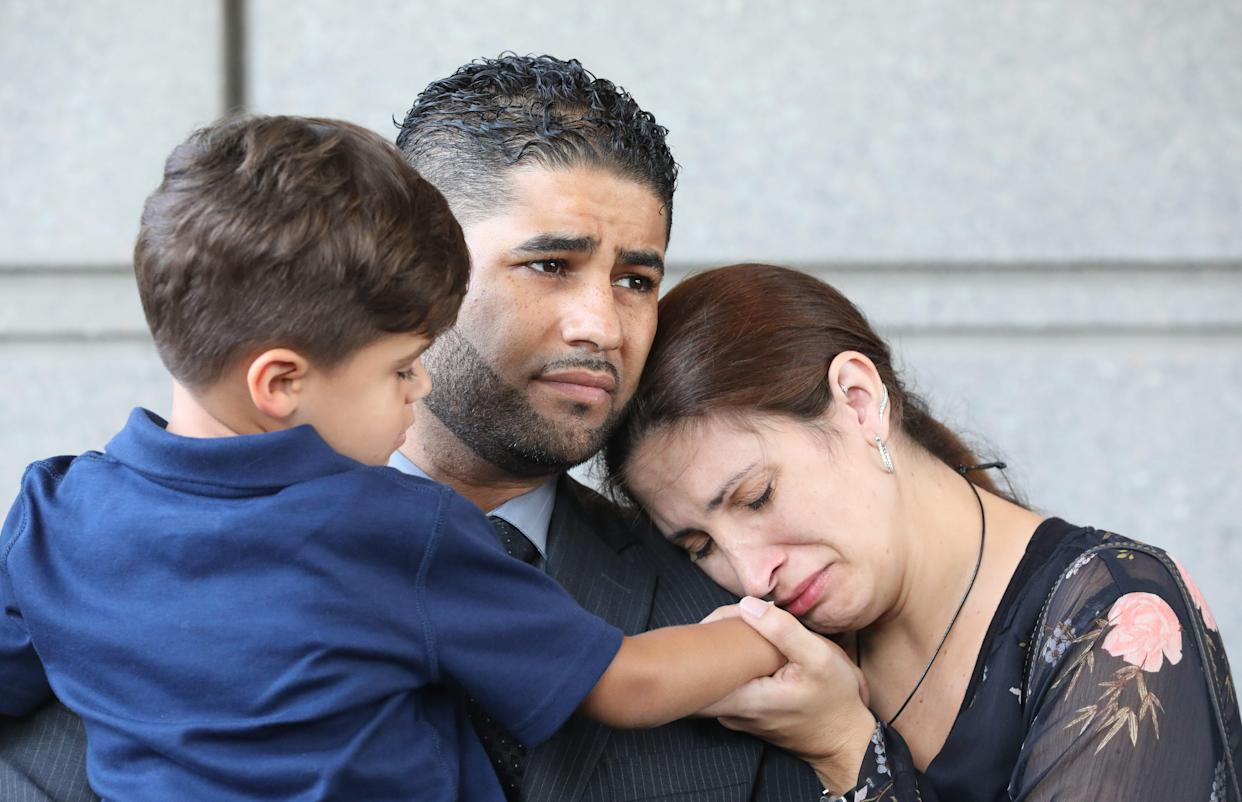 Juan Rodriguez from New City with son Tristan, 4, and wife Marissa, are pictured outside of a Bronx courthouse Aug. 1, 2019. He was there to face charges after he left his 1-year old twins in a hot car, where they died.
