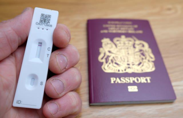 Later in October, eligible fully vaccinated passengers can take a cheaper lateral flow test instead of a PCR test as their day two test (Andrew Matthews/PA)