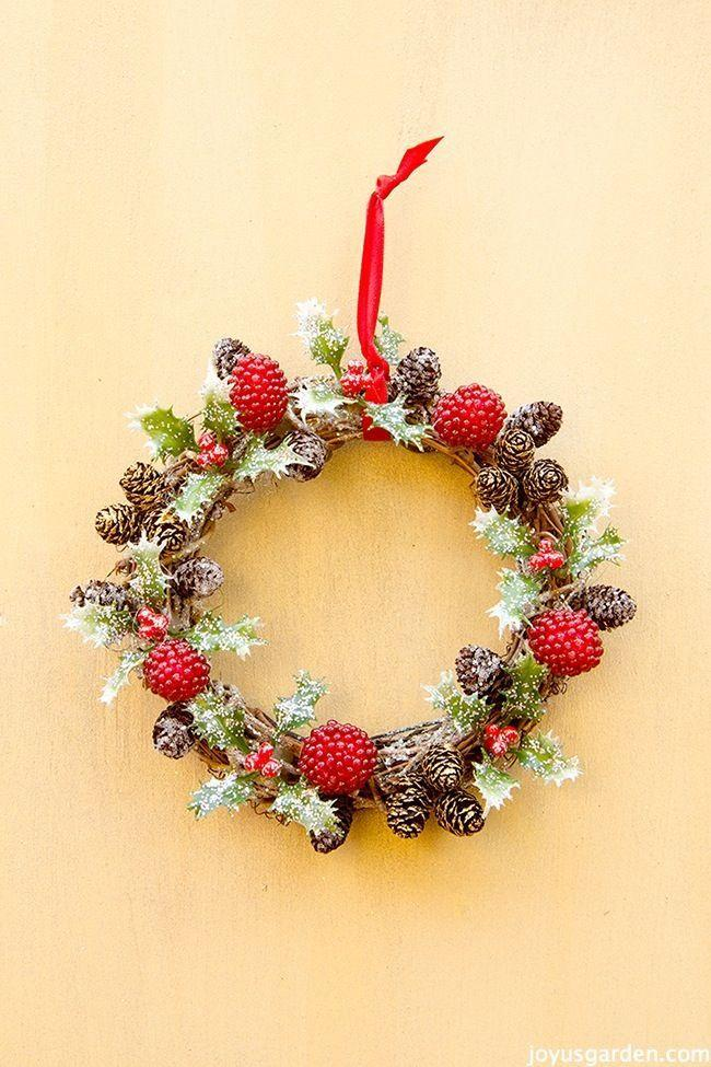"""<p>This stem wreath features holly berries and frosted leaves as festive accents.</p><p>Get the tutorial at <a href=""""http://www.joyusgarden.com/holly-berry-vine-wreath-christmas-ornament/"""" rel=""""nofollow noopener"""" target=""""_blank"""" data-ylk=""""slk:Joy Us Garden"""" class=""""link rapid-noclick-resp"""">Joy Us Garden</a>.</p>"""