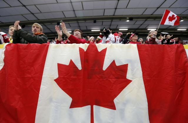Canada supporters cheer during a break in play against Germany of their IIHF World Junior Championship ice hockey game in Malmo, Sweden, December 26, 2013. REUTERS/Alexander Demianchuk (SWEDEN - Tags: SPORT ICE HOCKEY)
