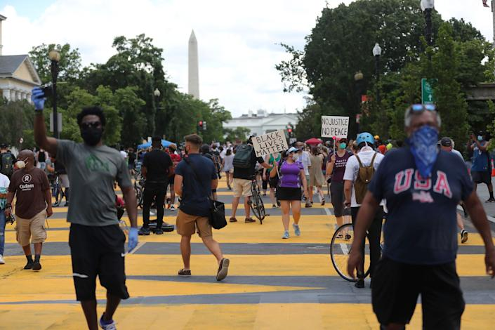 With the Washington Monument looming in the background, protesters march for racial justice on the streets of the District of Columbia near the White House on June 5. (Photo: mpi34/MediaPunch/MediaPunch/IPx)