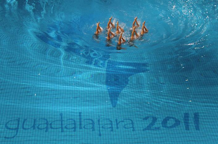 Brazil's team competes in the synchronized swimming technical routine preliminary at the Pan American Games in Guadalajara, Mexico, Wednesday, Oct. 19, 2011. (AP Photo/Silvia Izquierdo)