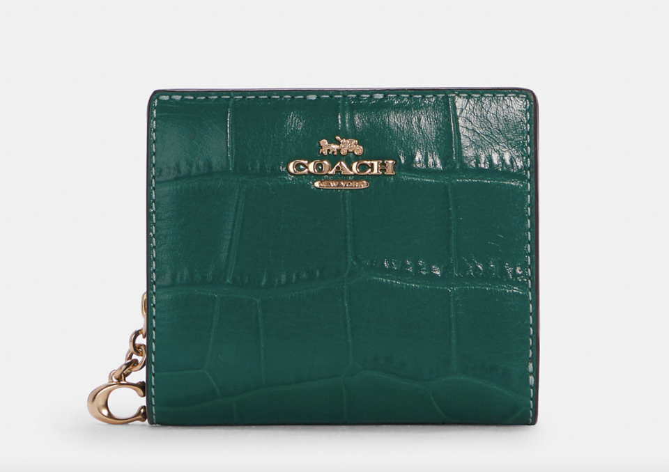 dark green leather Snap Wallet (Photo via Coach Outlet)