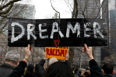 Activists and DACA recipients march up Broadway during the start of their 'Walk to Stay Home,' a five-day 250-mile walk from New York to Washington D.C., to demand that Congress pass a Clean Dream Act, in Manhattan, New York, U.S., February 15, 2018. REUTERS/Shannon Stapleton/Files