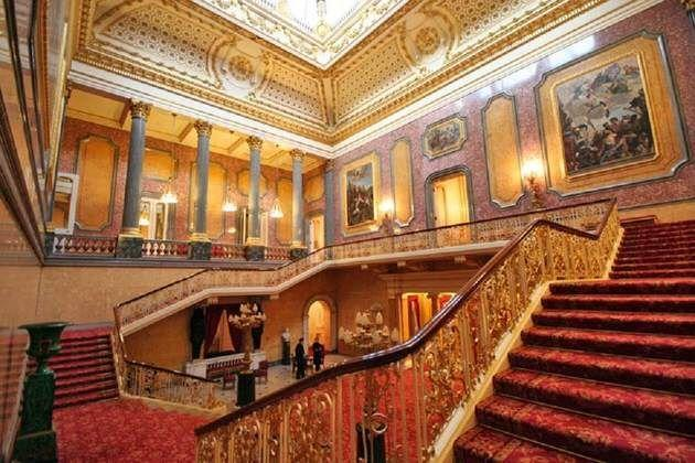 """<p>Lancaster House was enlisted to play the part of Buckingham Place's interiors, and it even has its own ties to royalty—the Duke of York commissioned Lancaster House's creation in 1825. This Neoclassical mansion is typically only open to the public for the annual Open House London festival, a weekend-long event that allows visitors to tour architectural sites that are usually closed to the public, including Marlborough House, Horse Guards, Mansion House, and the Foreign, Commonwealth and Development Office. Better yet, you don't even need to leave your own home to tour Lancaster House—you can <a href=""""https://blogs.fcdo.gov.uk/lancasterhouse/virtual_tour/LH-FINAL-TOUR/tour.html"""" rel=""""nofollow noopener"""" target=""""_blank"""" data-ylk=""""slk:virtually tour"""" class=""""link rapid-noclick-resp"""">virtually tour</a> it at no cost!</p>"""