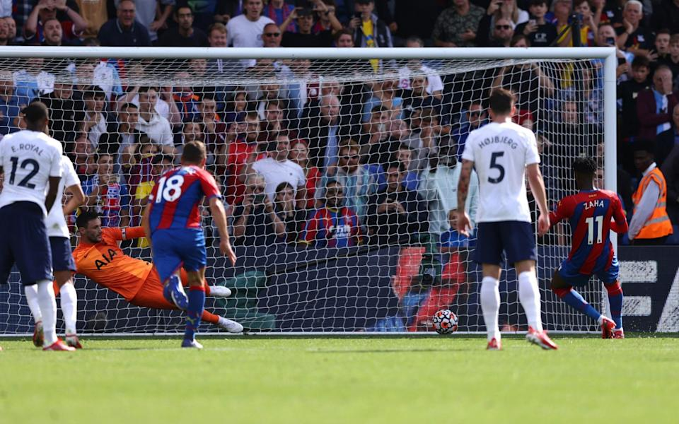 Wilfried Zaha of Crystal Palace scores their side's first goal - Paul Harding/Getty Images