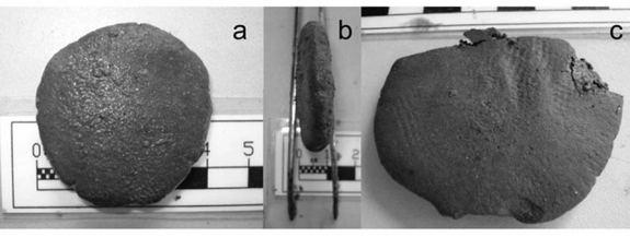 The front (A) and profile (B) of a tablet found in the shipwreck; Impression on the surface of the tablet left by pressure from some kind of fabric (C).