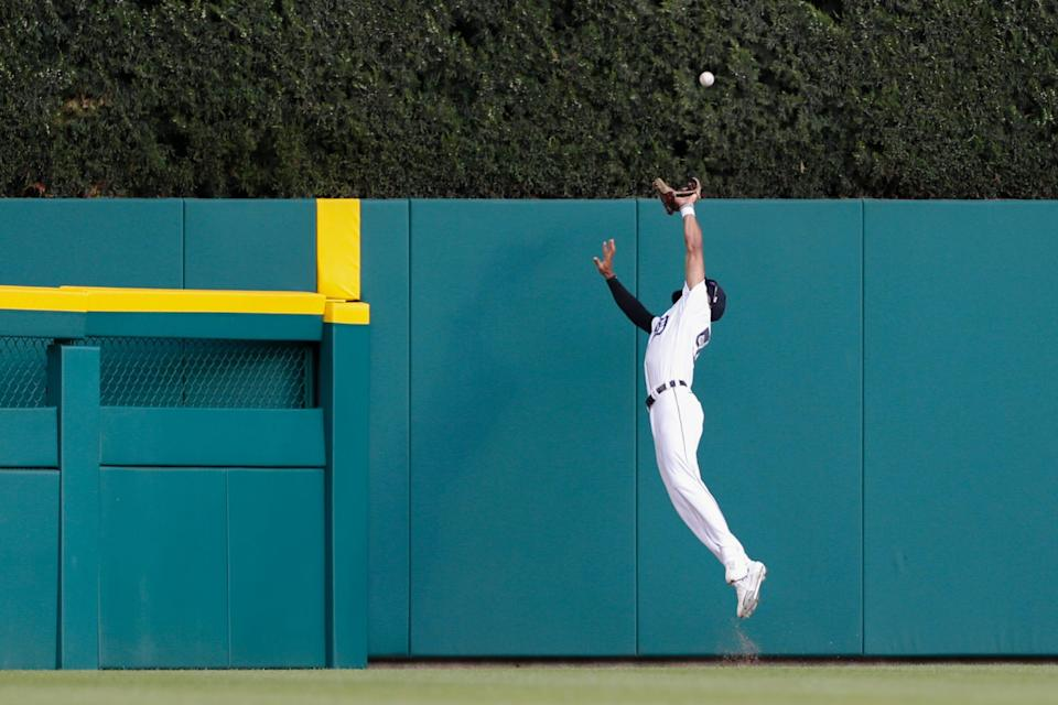 Detroit Tigers center fielder Derek Hill (54) makes a leaping catch at the wall for an out against Seattle Mariners third baseman Kyle Seager (not pictured) during the first inning at Comerica Park.