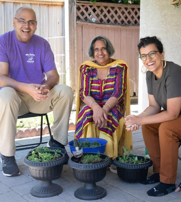 From left: Alex Sangha, producer and founder of Sher Vancouver, his mother Jaspal Sangha, and Jagandeep Nagra outside the Sanghas' home in Delta, B.C., on June 25. (Maggie MacPherson/CBC - image credit)