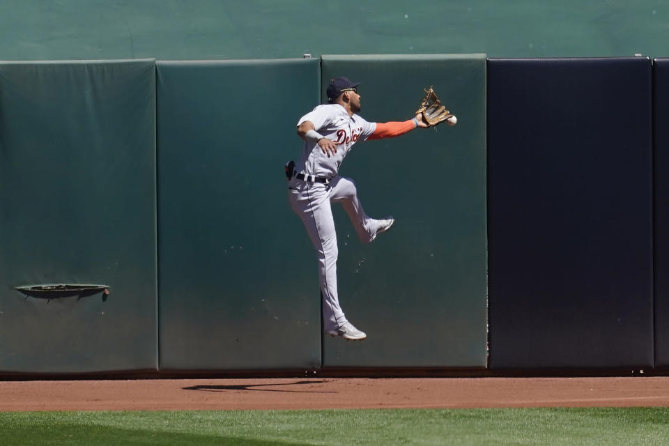 Detroit Tigers center fielder Victor Reyes cannot catch a run-scoring triple hit by Oakland Athletics' Ramon Laureano during the fourth inning of a baseball game in Oakland, Calif., Sunday, April 18, 2021. (AP Photo/Jeff Chiu)