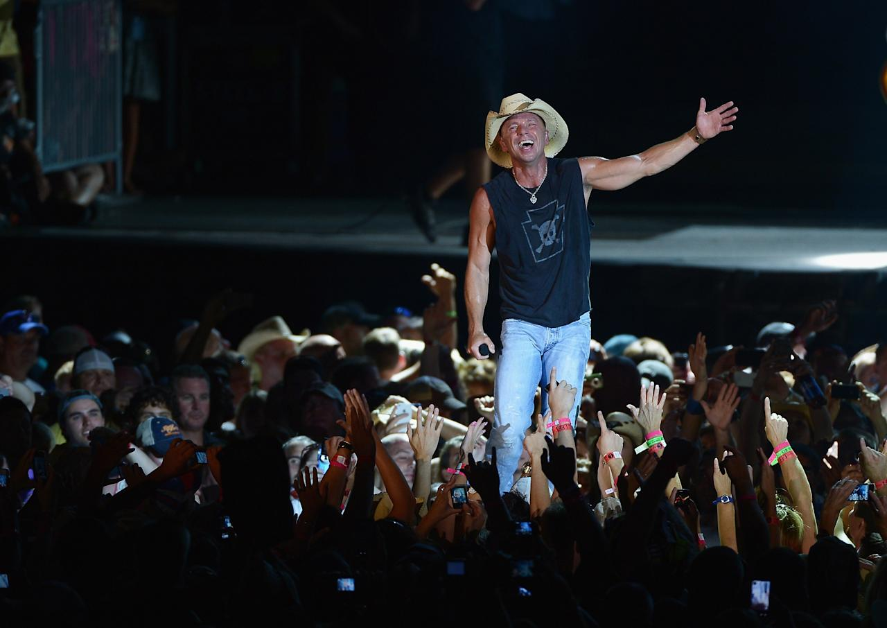 EAST RUTHERFORD, NJ - AUGUST 11:  Musician Kenny Chesney performs during the Brothers of the Sun tour at MetLife Stadium on August 11, 2012 in East Rutherford, New Jersey.  (Photo by Michael Loccisano/Getty Images)