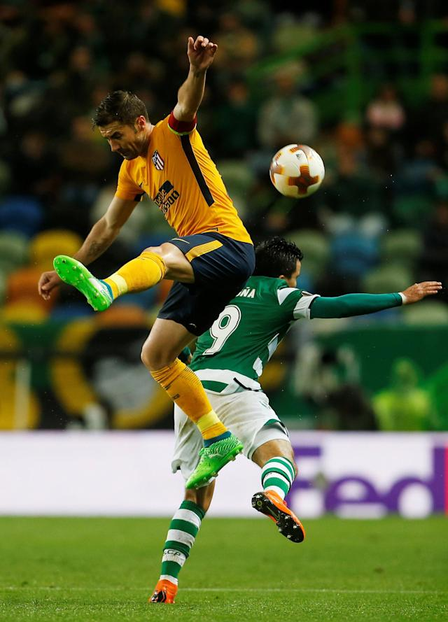 Soccer Football - Europa League Quarter Final Second Leg - Sporting CP v Atletico Madrid - Estadio Jose Alvalade, Lisbon, Portugal - April 12, 2018 Atletico Madrid's Gabi in action with Sporting's Marcos Acuna REUTERS/Pedro Nunes