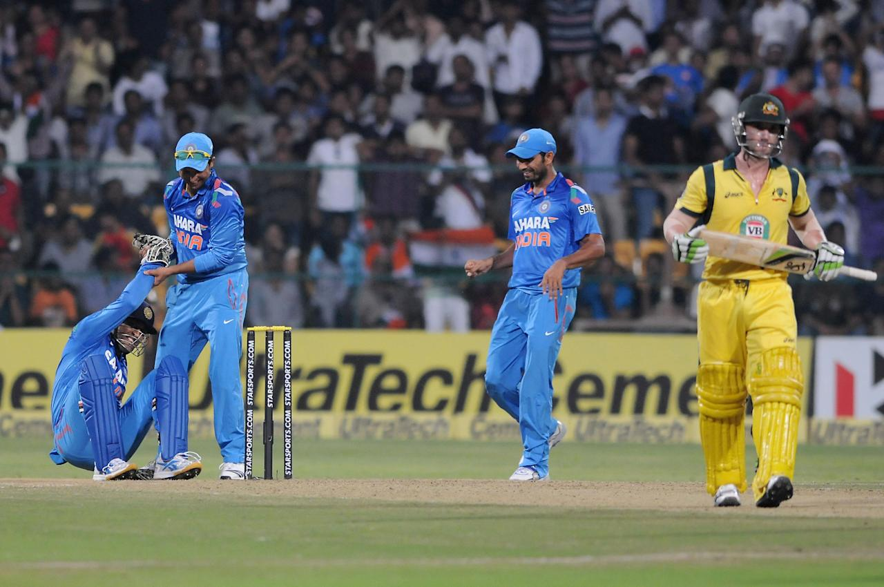Indian players celebrate wicket of Phillip Hughes during the 7th ODI between India and Australia played at Chinnaswamy Stadium in Bangalore on Nov.2, 2013. (Photo: IANS)
