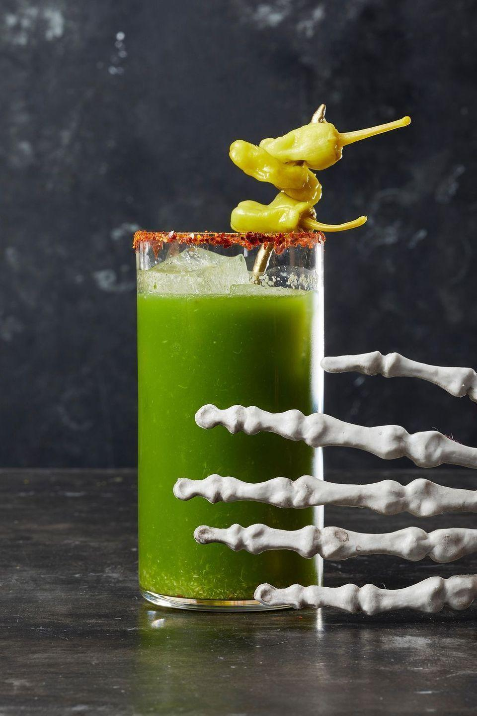 "<p>Blend up this eerie twist on a classic Bloody Mary to serve for your Halloween party.</p><p><em><a href=""https://www.goodhousekeeping.com/food-recipes/a28553276/swamp-thing-recipe/"" rel=""nofollow noopener"" target=""_blank"" data-ylk=""slk:Get the recipe for Swamp Thing »"" class=""link rapid-noclick-resp"">Get the recipe for Swamp Thing »</a></em> </p>"