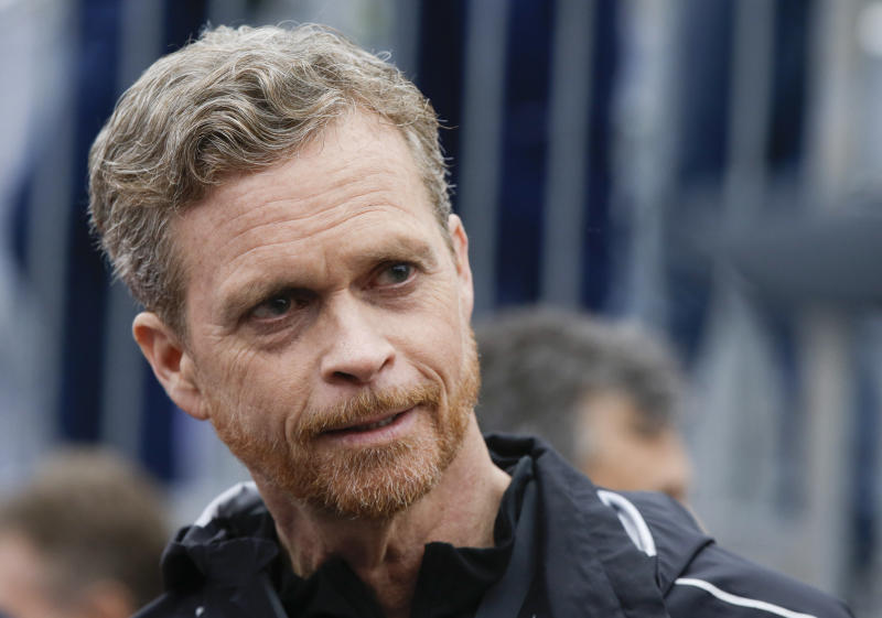 FILE - In this May 6, 2017, file photo Nike CEO and President Mark Parker talks at the finish line of a 2 hours marathon, at the Monza Formula One racetrack, Italy.  Parker is stepping down early next year. He will be replaced by board member John Donahoe, who formerly ran e-commerce company eBay. (AP Photo/Luca Bruno, File)