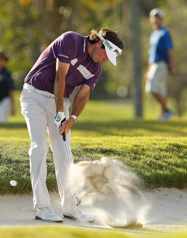MIAMI, FL - MARCH 10: Bubba Watson hits out of the bunker on the 16th hole during the third round of the World Golf Championship's Cadillac Championship at Doral Golf Resort And Spa on March 10, 2012 in Miami, Florida. (Photo by Mike Ehrmann/Getty Images)