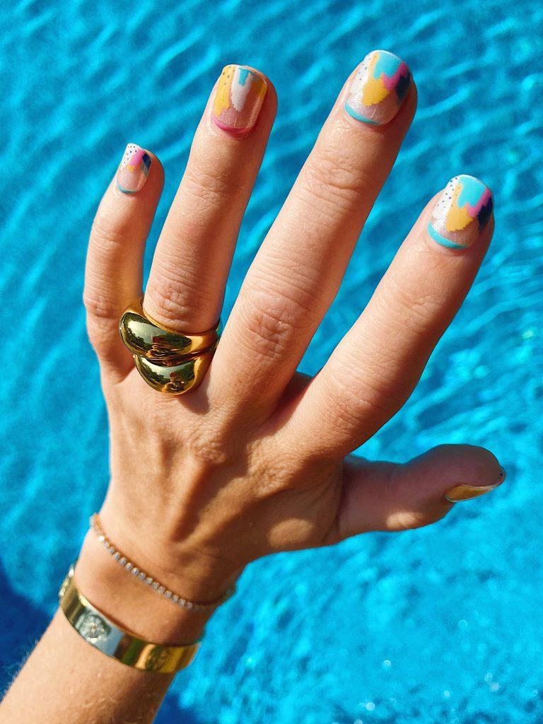 This photo was taken on Day 6 of wearing the Painterly Pastels nails. // Credit: Ellie Conley for In The Know