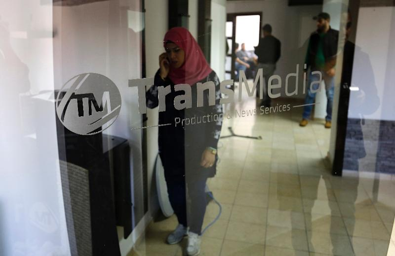 Palestinian employees of Palestine Today television inspect the damage at the station's offices after it had been raided by Israeli forces overnight on March 11, 2016, in the West Bank city of Ramallah